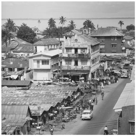 Homes and market near the Lagos Lagoon. Nigerian cities have grown to resemble western urban centers.