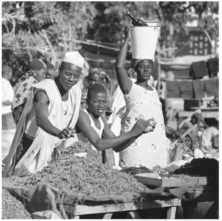 Nigerian people at a market. Food plays a central role in the rituals of all ethnic groups in Nigeria.
