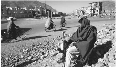 An Afghani man sits in the rubble of Kabul, Afghanistan in 1995. Between 1992 and 1995, the Taliban seized control of southern Afghanistan.