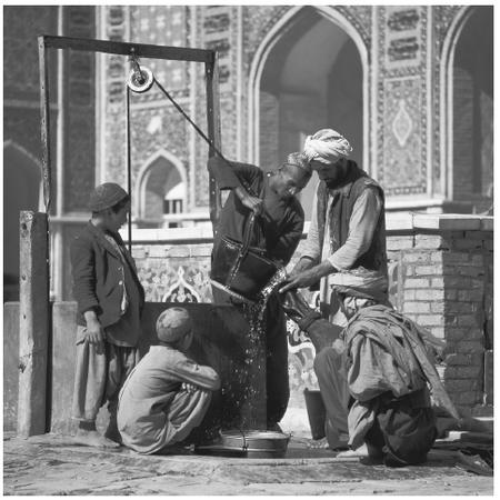 Men gather water from a mosque well. The roles of Afghani men and women differ strongly, both in terms of daily tasks and personal empowerment.