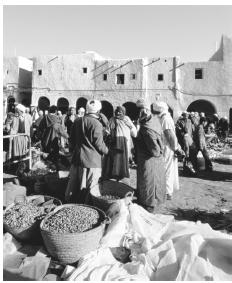 The center of Algerian commercial life is the souk , or open-air market.