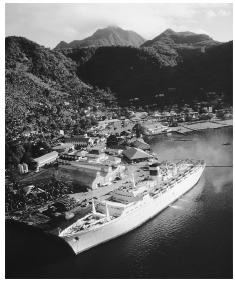 A cruise ship moored at Pago Pago. Visitors to American Samoa help boost the local economy.