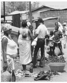 Street vendors at a market area in Luanda. Small market trade is very important to Angolan survival.
