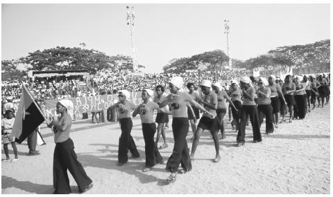 A march to celebrate the 1961 war for liberation, held in a stadium in Luanda, in 1975.