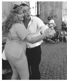 A couple dance to the music of street performers in La Boca, a working-class neighborhood in Buenas Aires which was the first stop for many immigrants coming to the New World.