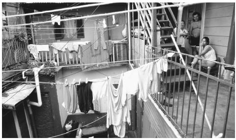 Laundry hanging above a courtyard in La Boca, a working-class neighborhood in Buenos Aires. The economic crises of the 1980s and 1990s caused many middle-class citizens to experience downward mobility.