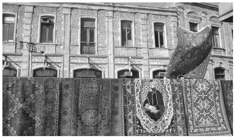 Carpets for sale in front of a building in Baku. Traditional carpet weaving is a large component of Azerbaijani commerce.