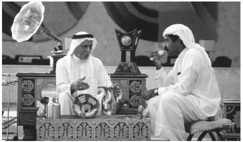 Men partake in the traditional past-time of coffee-drinking in the Gulf Hotel in Manama. The scarf that covers a man's head is called a  gutra.