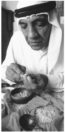 "A pearl merchant in his shop in Manama. Bahr is an Arabic word meaning ""sea."""