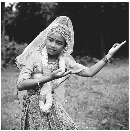 A young Bengali woman performs a traditional Manipuri dance. Almost all traditional dancers are women.