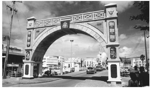 An arch extends over a road in the capital city of Bridgetown. The majority of the population, about 80 percent, live in or near the city.