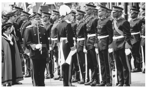 The Governor of Bermuda inspects troops of the Bermuda Regiment during the annual Peppercorn Ceremonies, St. George, Bermuda.