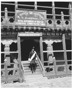 A government official walking out of an administrative building in Tongsa. Bhutan is a constitutional monarchy.