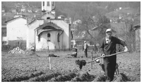 Men work in a field in Maglaj, during the Yugoslavian Civil War. Most food must be imported because farming does not meet subsistence needs.
