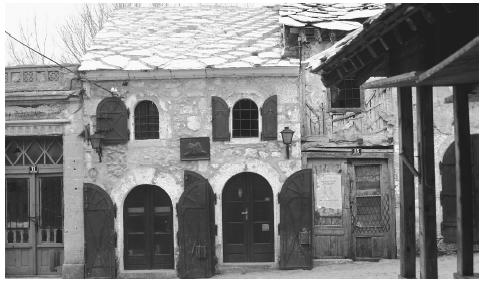 A building with arched double doors in Mostar, the largest city in the Herzegovina region. Mostar was badly damaged by the civil war.
