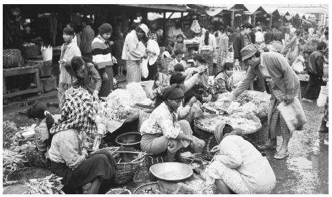Mingalla Market, Mandalay. Men and women engage equally in small marketplace selling and trading.