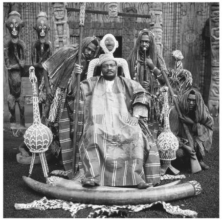 Many Cameroonians have a highly stratified social structure. The intricately beaded calabashes (gourds) and carvings indicate this tribal king's royal status.