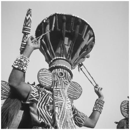 A Bamiléké tribesman wearing a mask during a traditional ritual in Cameroon.