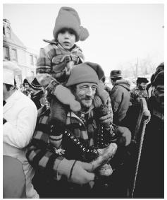 A father and son celebrate their lumber heritage during the winter Lumberjack Parade in Chicoutimi, Quebec.