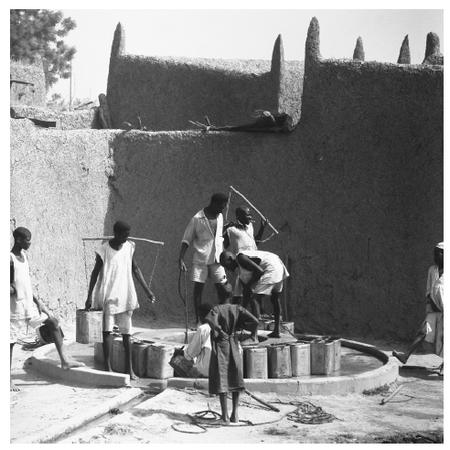 Children and adolescents rarely pursue a complete education in Chad. These young men and boys are helping their households by drawing water from a well.