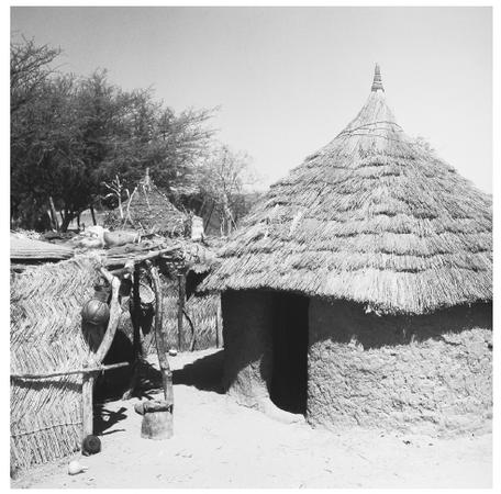 A traditional mud hut stands in the village of Massaguet, but modern, iron-and-concrete buildings are being built more frequently throughout Chad.