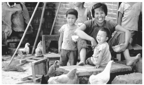 A mother and her children in a farming commune in Canton. Only ethnic minority families are allowed to have more than one child.