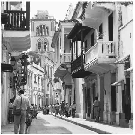 A street scene in the Colombian town of Cartagena. Houses in Colombia's cities often have two or more stories and reflect a European style.