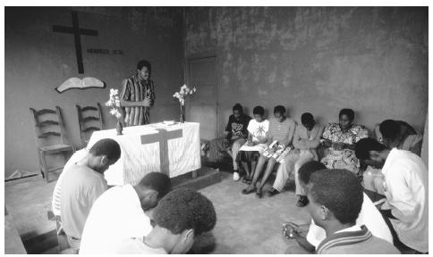 A congregation prays at an Assembly of God in Bukavu. Due to the efforts of missionaries, the majority of Congolese practice Christianity.