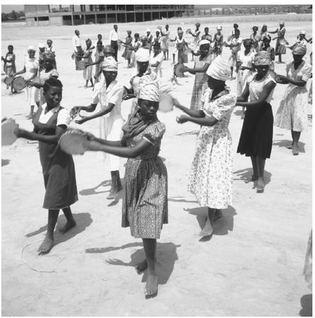 A number of female students at a college in Kinshasa, learning dance. There are four universities located in the Congo.