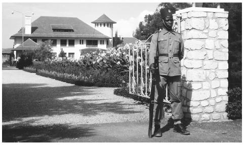 A guard stands at the gate to the palace of the governor of Kivu.
