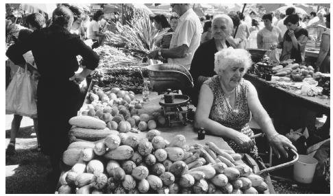 A woman sells produce at an open air market within the Diocletian Palace walls in Split.
