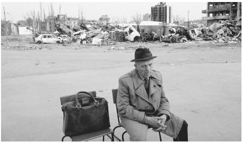 A man sits among the ruins of Vukovar, destroyed by fighting in 1991. The four-year struggle between Croats and Serbs destroyed many cities.