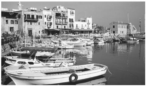 Boats moored in the harbor at Kyrenia. In seaside towns and villages, tourism and fishing are important parts of the economy.