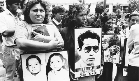 Families with pictures of loved ones at a demonstration in Quito, circa 1989. The Ecuadoran people look to the government for protection, but also expect corruption.