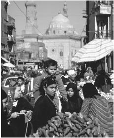 People fill the street in a Cairo market.