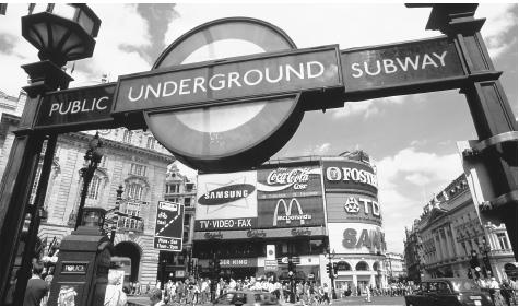 Advertisements and a sign for the Underground in London's busy Piccadilly Circus.