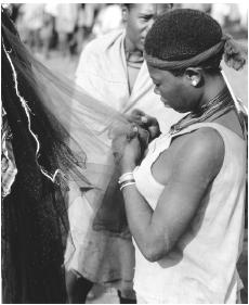 An Ethiopian woman looking at fabric in Fasher.