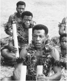 A group of musicians at a Kavo Ceremony. Both sacred and secular music are popular in Fiji.