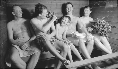 A Finnish family in a sauna in Oulu, Finland. Saunas provide a less formal, more open space for reserved Finns to express themselves.