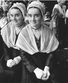 Breton girls in costumes for a festival. Each commune generally holds a festival during the year.