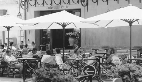 People at an outdoor café in France. Cafés are social centers for men in southern France and are also popular among tourists.
