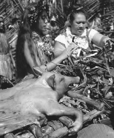 Roasting a pig at a festival in Atuona, Hiva Oa. Rural Polynesians provide much of their own food and generally cook only one meal each day.