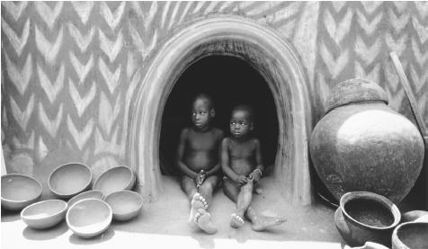 Children taking shelter from the midday heat. Located just north of the equator, Ghana has a warm, humid climate.