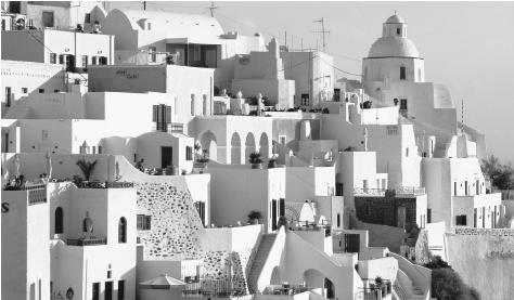 Houses in Santorini, Greece. Much Greek housing has traditionally been small and owner-built, and a high value is placed on home ownership.