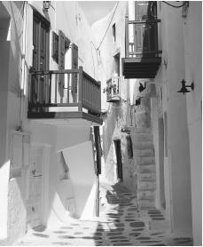 A narrow street in the Old Town section of Mykonos, Greece.