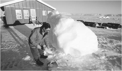 A person collecting ice for drinking water in Qaanaaq, Greenland. In Greenland's subarctic climate, temperatures average only fifty degrees at the height of summer, and only along the southwest coast.