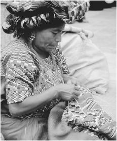 A woman embroidering in Antigua. Handicrafts have been produced and widely traded in Guatemala for centuries.