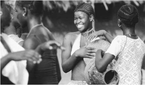 Teenagers from Bijagos Islands playing the drums. Almost all children receive primary education in Guinea-Bissau.