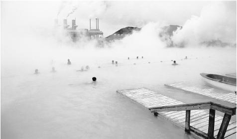 Swimmers bathe in the Blue Lagoon thermal baths in Iceland.