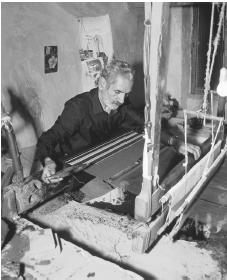 A carpet maker works on a loom at his shop in Na'in.